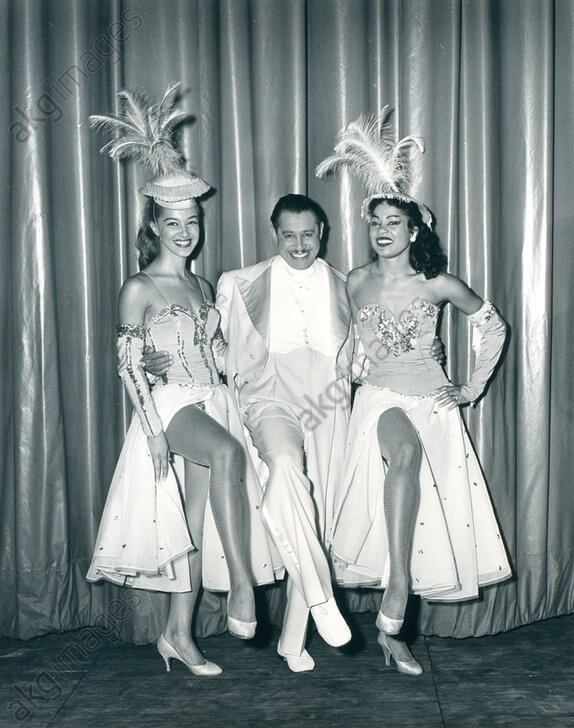 1957 0701 CAb Calloway and 2 dancers Cotton Club Revue by Abbie Rowe.jpg